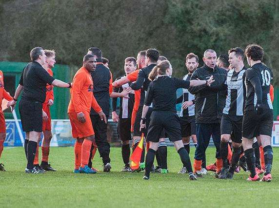 COMING TOGETHER: Things got heated at Diss Town as the officials had to separate players and coaching staff in a game which saw The Tangerines play an hour with 10 men. Picture: Al Pulford