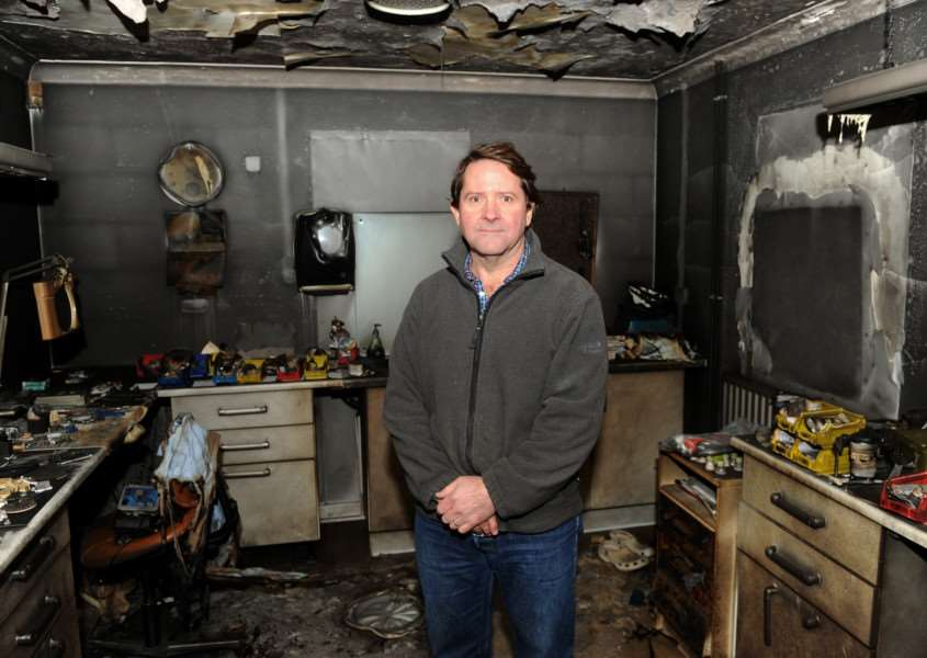 Marthinus Robbertse in one of the rooms at the 2,000 sq ft building destroyed by fire and smoke damage