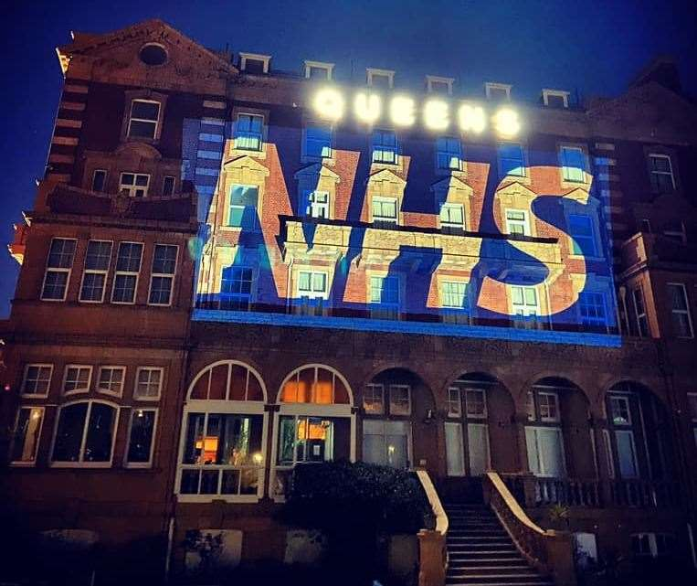 THERE FOR YOU: Queen's Hotel lit up for the NHS
