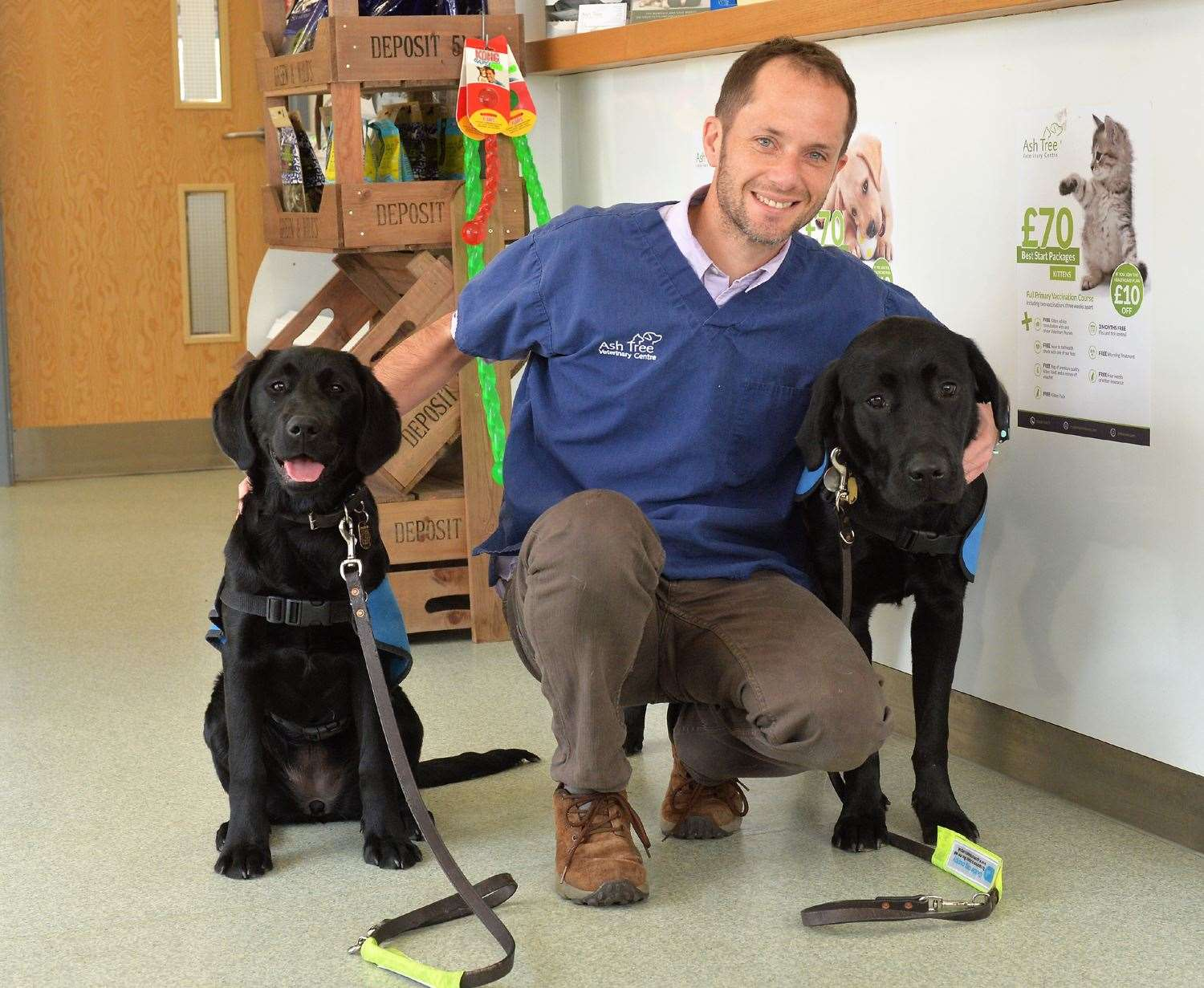 Ash Tree Vet Bill Besley with guide dogs in training Cathy and Quince (8619689)