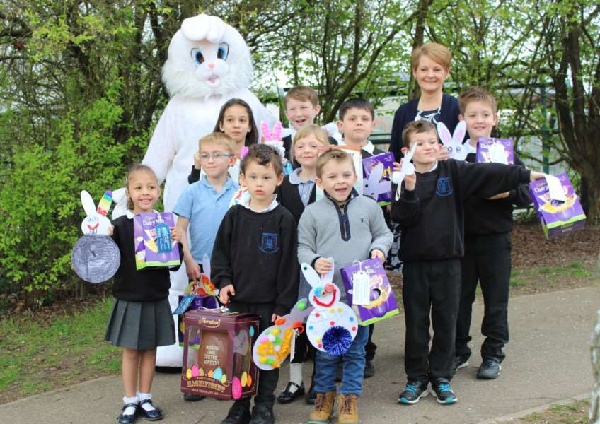 Children at Westgate Primary School, in Bury St Edmunds, with the Easter Bunny and Karen Finch, MD of The Hearing Care Centre