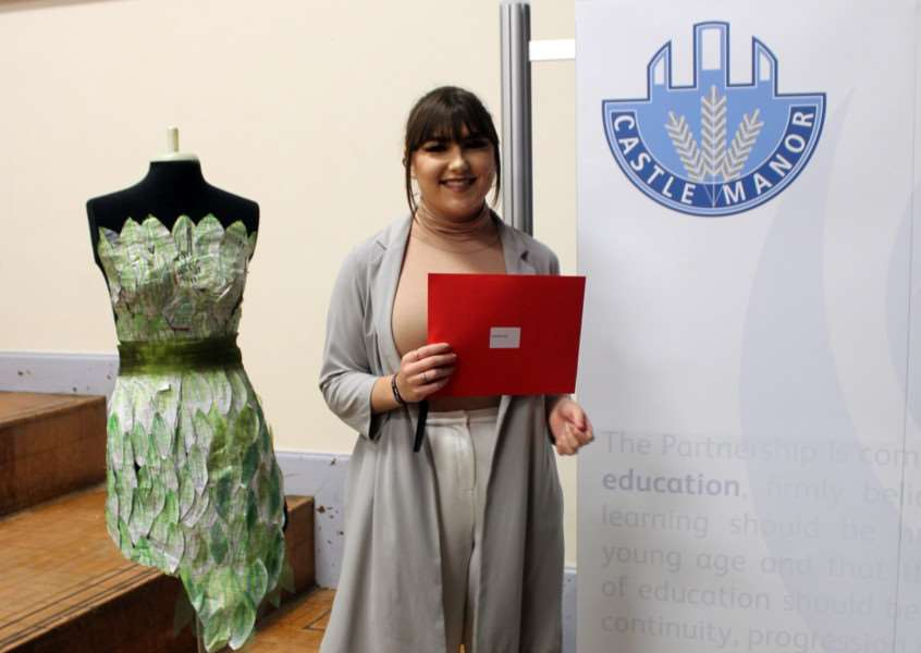 India Bavester collecting her certificates at the Castle Manor Academy Celebration of Achievement Awards. Next to India is an example of her textiles work. ANL-150212-150945001