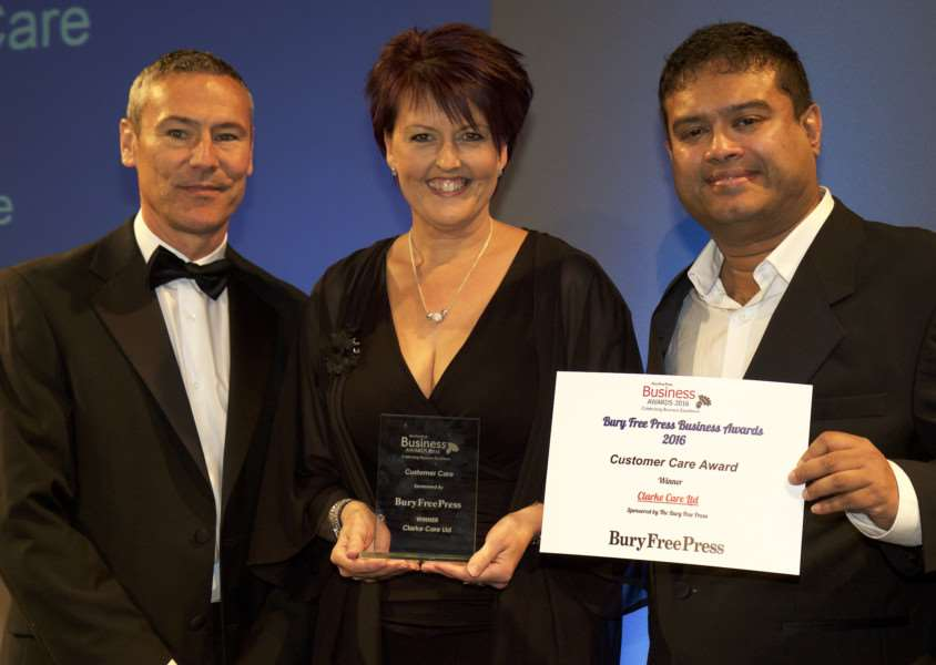 Lorraine Clark from Clarke Care gets her Customer Care Award 2016 from BFP advertising manager Jamie Brodie, left, and compare Paul Sinha