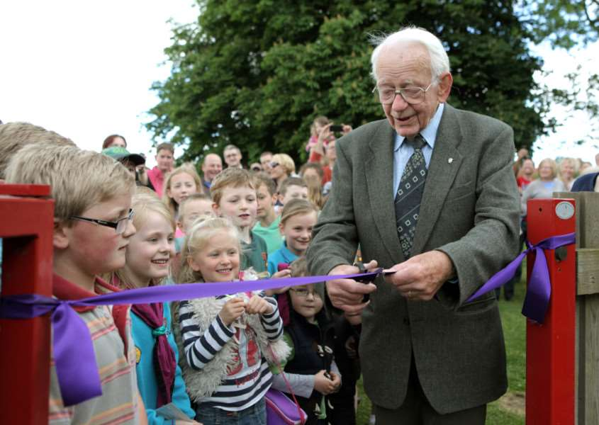 Councillor Derek Redhead, seen here cutting the ribbon to open Wickhambrook childrens play area, was one of nine to receive a long service award from St Edmundsbury Borough Council.'' ENGANL00120130617115845
