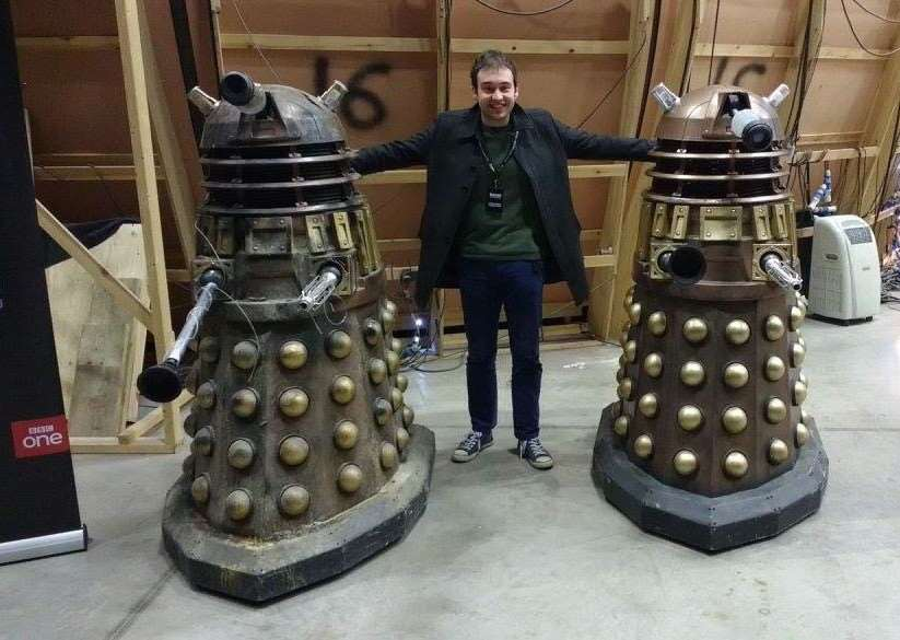 Hayden Gribble pictured with two of the iconic Daleks that have featured in Doctor Who