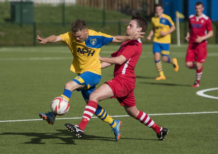 TIGHT TUSSLE: Haverhill Rovers make a tackle on their hosts Newmarket