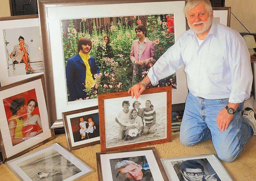 Tom Murray with some of his iconic shots of celebrities going on show at Jacobs Allen Chartered Accountants' new home in Bury St Edmunds