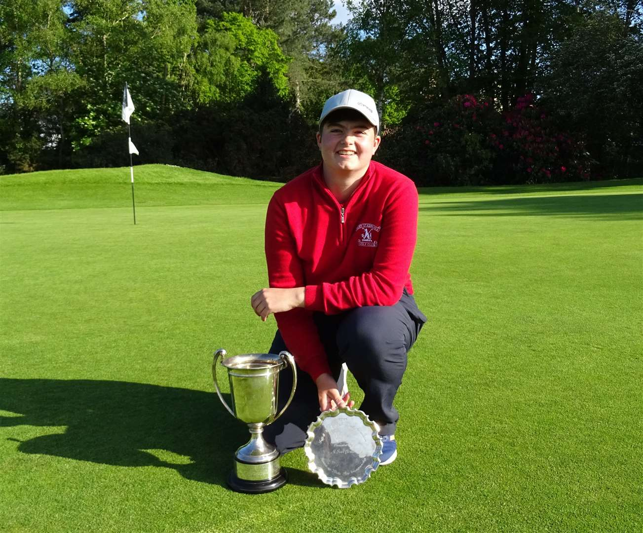 Alice Barlow with her Suffolk Match Play Cup and Stroke Play runner-up silver plate