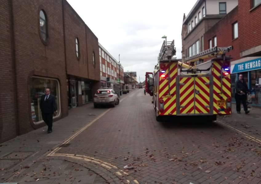 Haverhill High Street is closed to pedestrians in the area at the front of Heron House after the covering blew off its roof. Picture by Steve Barton.