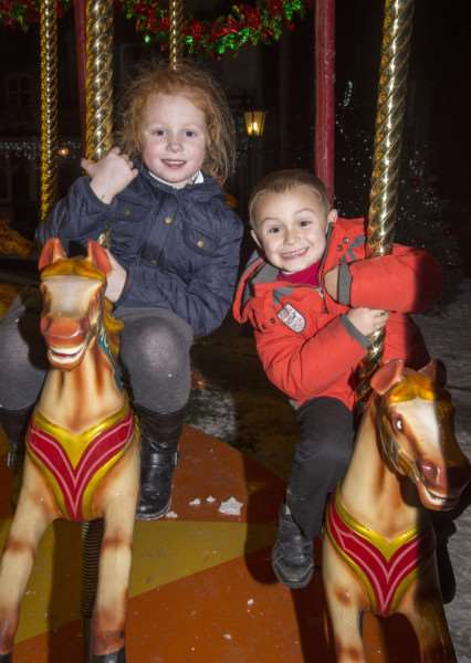 Teddy Williams 4 from West Row and Tia McKenzi-Scott aged 6 from Mildenhall on the carousel