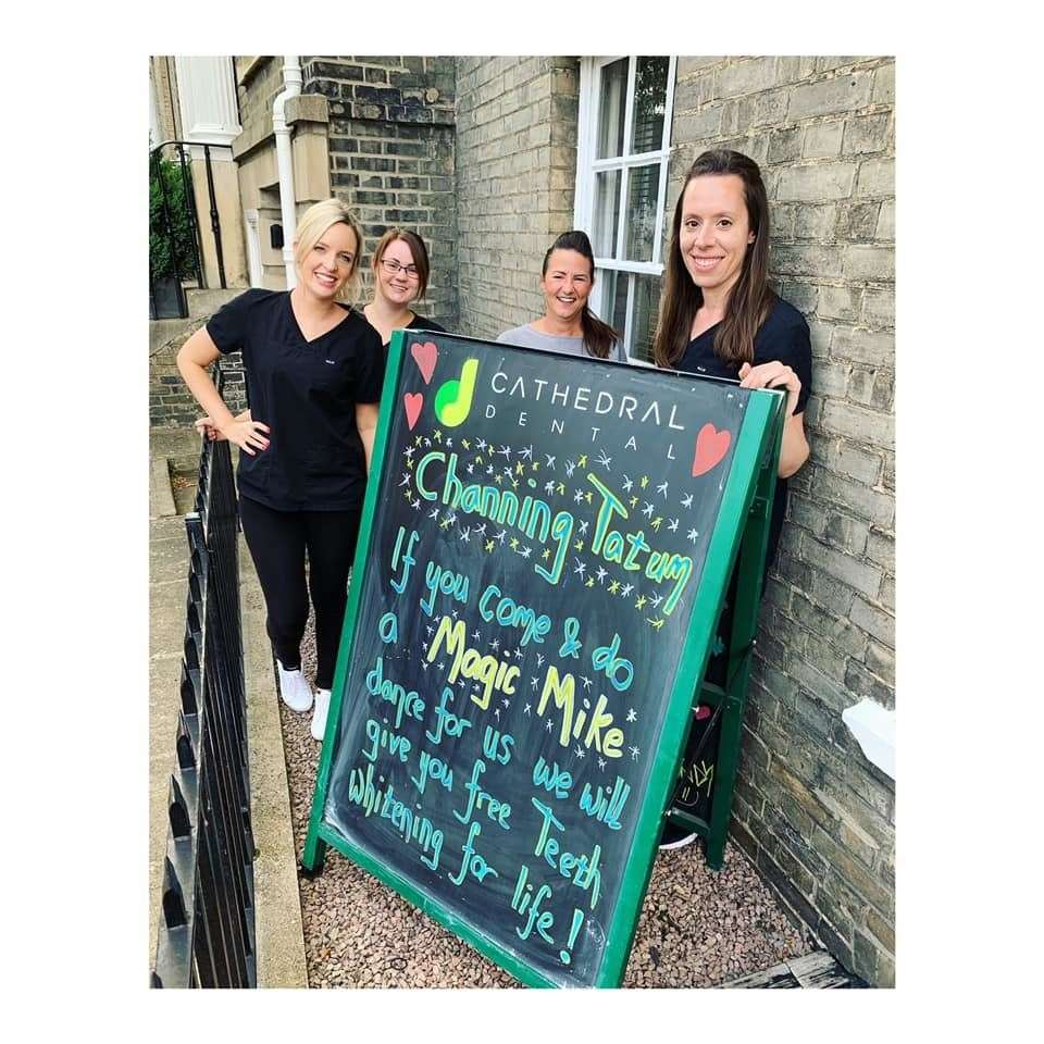 Danah Mapson, Rachel Davis, Bev Law and Mel Baynham from Cathedral Dental with the sign.