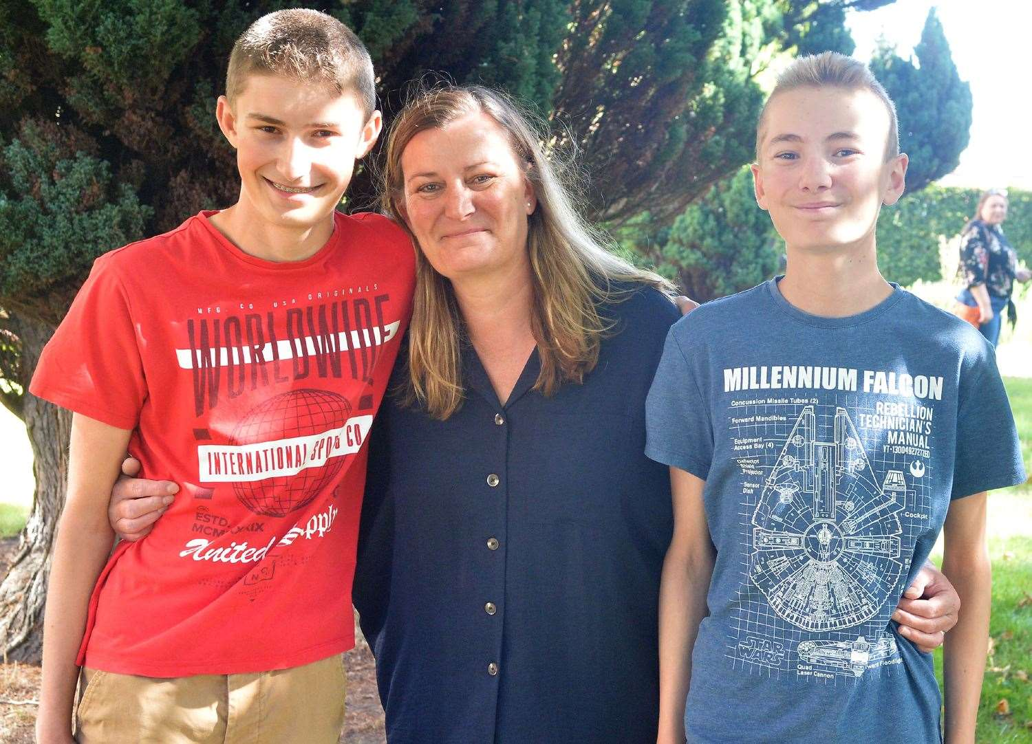 Mandy Clarke with sons Ethan, left, who collected his GCSE results today from Newmarket Academy and Adam.(40905819)