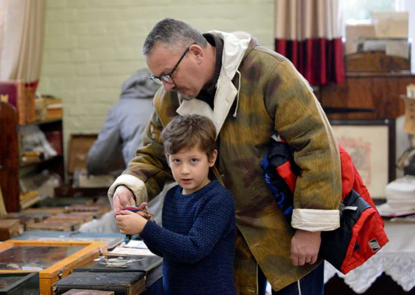 Antiques and Vintage Fair at The Old School Community Centre in Long Melford. James Kitcher (7) with Dad Kevin admiring some WW2 medals.