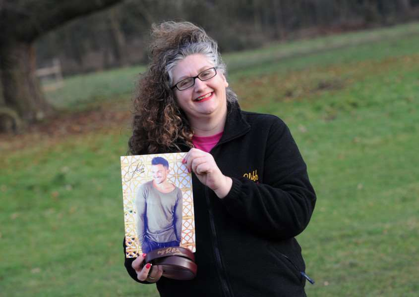 Sarah Smith is set to shave her head and raffle off prizes including these signed by Sir Cliff Richard and Peter Andre PICTURE: Mecha Morton