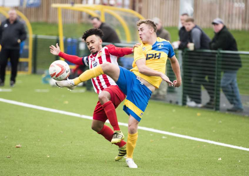 HOME DEFEAT: Deakan Napier competes for the ball with Amar Lewis during Newmarket's loss to Stowmarket