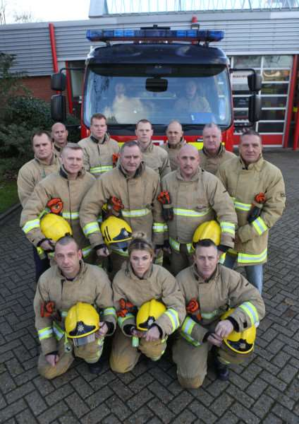 Firefighters from Bury St Edmunds pictured with the appliance that may be lost due to cut backs. ANL-151125-174532009