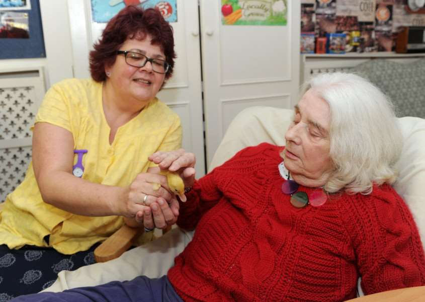 Risby Hall activities coordinator Katie Carter with resident Anne Attwood