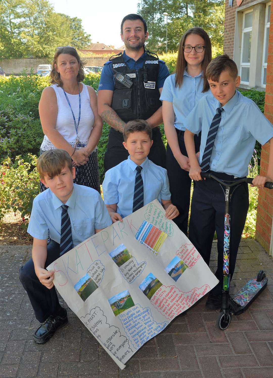 Skate park campaigners Dan Beynon, Leon Treharne, Ethan Eagling and Megan Conti-Lamont, pictured displaying some of their designs, with teacher Lisa Collins and PCSO Colin Gedney
