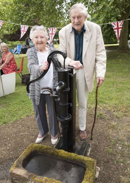 Two of the village's oldest residents Pat and Pat Tebbit with the pump ANL-161206-103044009