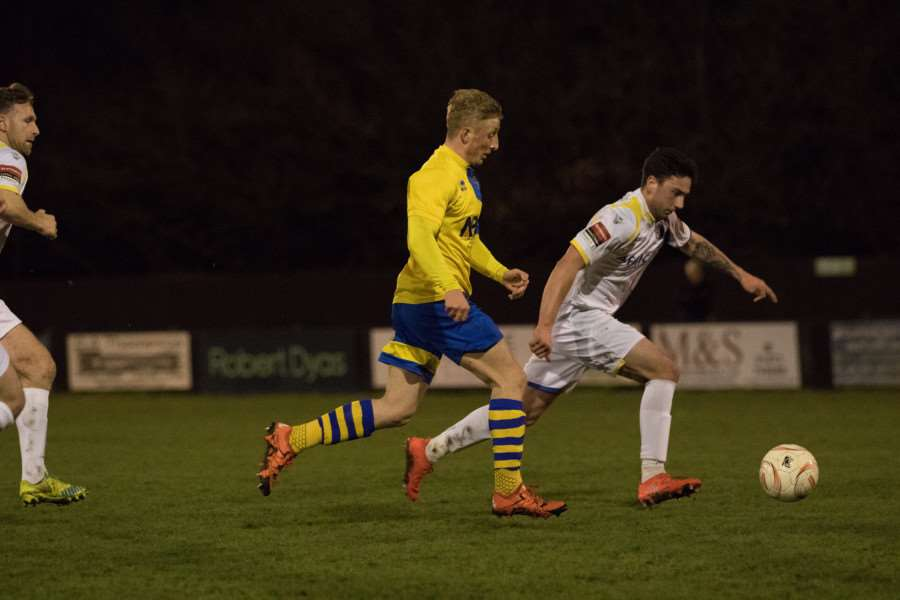 CHASING DOWN: Lewis Whitehead puts pressure on a Lowestoft defender