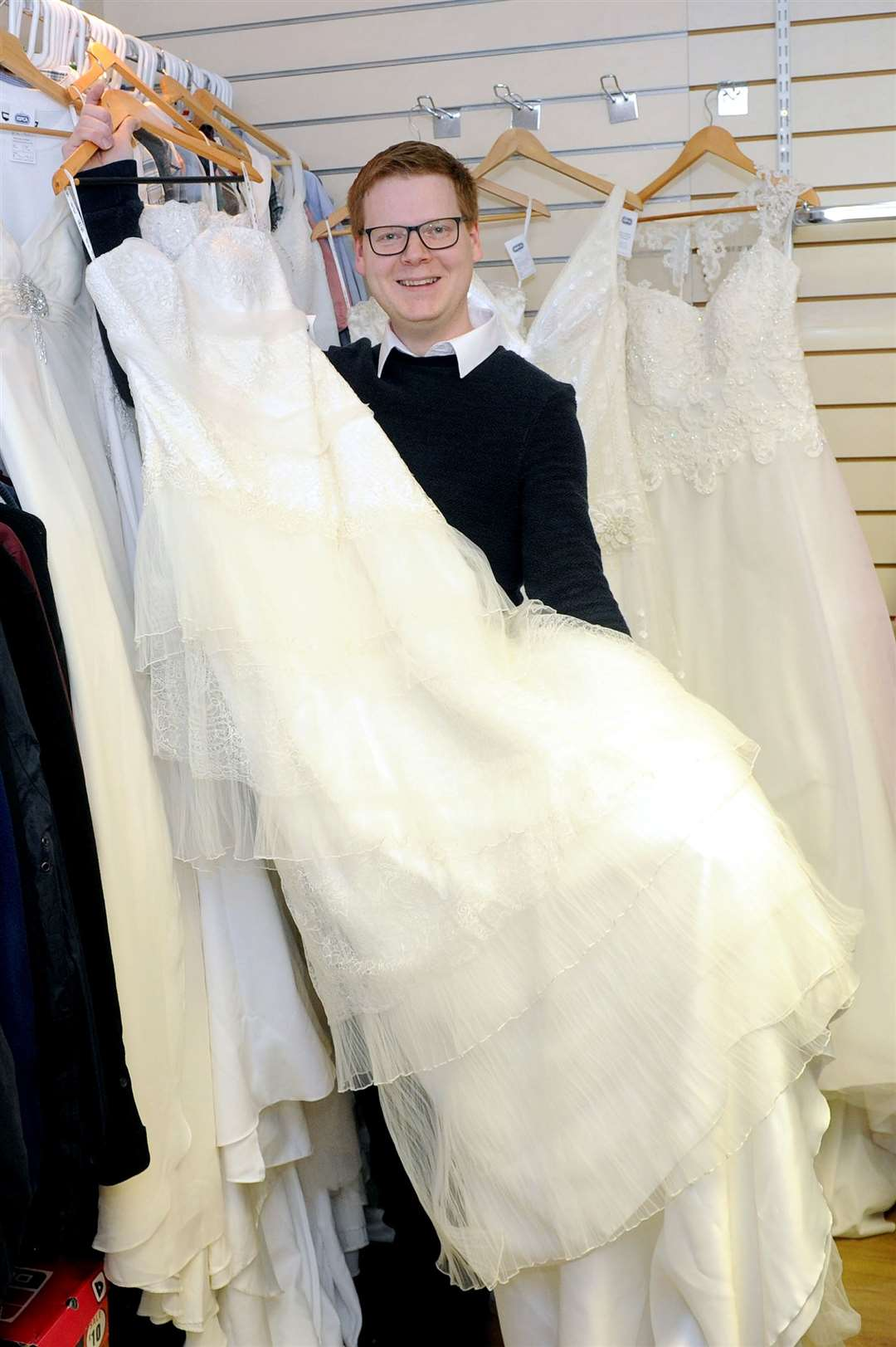 Ray Sinclair, shop manager surrounded by the wedding dressed which have been donated. Picture by Mecha Morton.