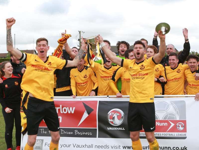 DOUBLE TROUBLE: Luke Butcher (left) and Gareth Simpson (right) lift the Thurlow Nunn League Challenge Cup trophy. Picture: Gary Donnison