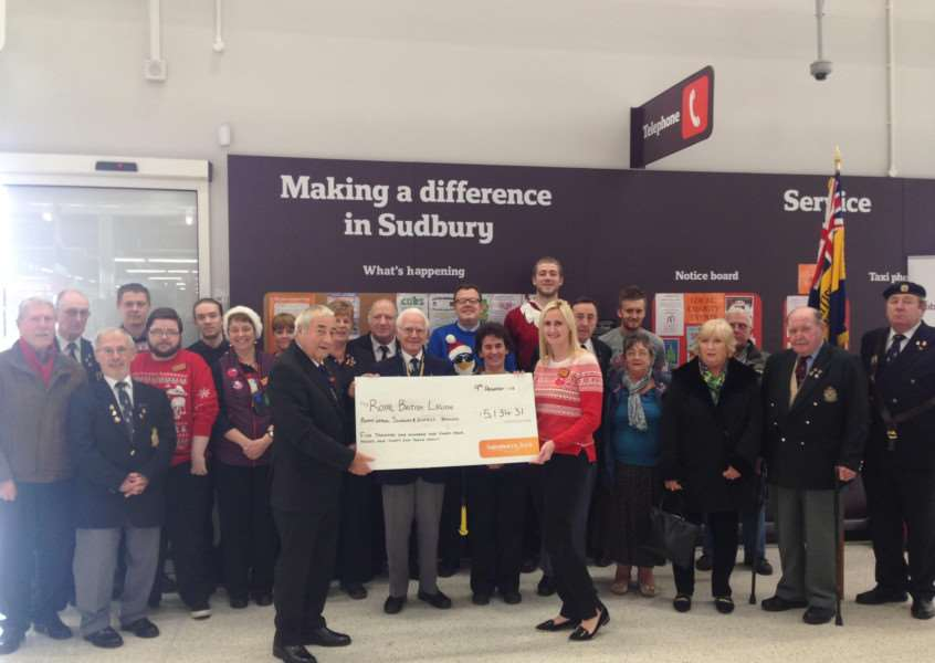 Staff at Sainsbury's hand over a cheque for �5,134.31 to Stuart Hume, chairman of the Sudbury branch of the Royal British Legion. The money was raised in store during this year's Poppy Appeal. ANL-151215-104647001