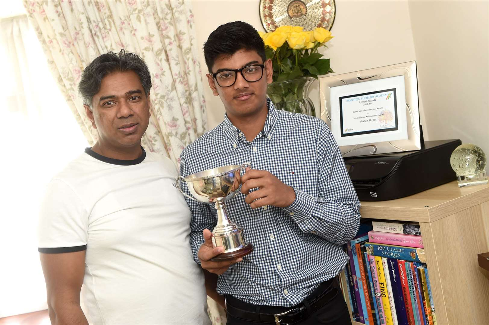 Shahan Al-Haq, of Long Melford, was recognised live on The Sunday Show on Channel S, a UK-based channel for the British Bangladeshi community, after winning the James McLellan Memorial Award, for being the highest-achieving A-level student at Ormiston Sudbury Academy...Pictured: Shahan with father Shah...PICTURE: Mecha Morton .... (17242991)