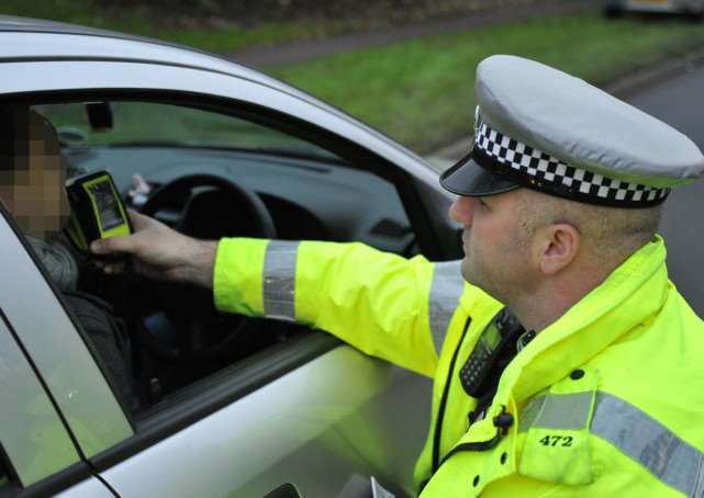 Police breathalyse a motorist
