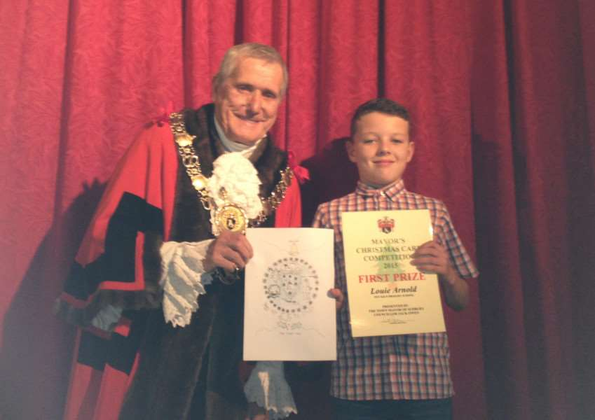 Louie Arnold, 11, from Pot Kiln Primary School was named the winner of the annual Sudbury Christmas card competition.''Pictured being given his certificate by Sudbury mayor Jack Owen ANL-151118-122702001