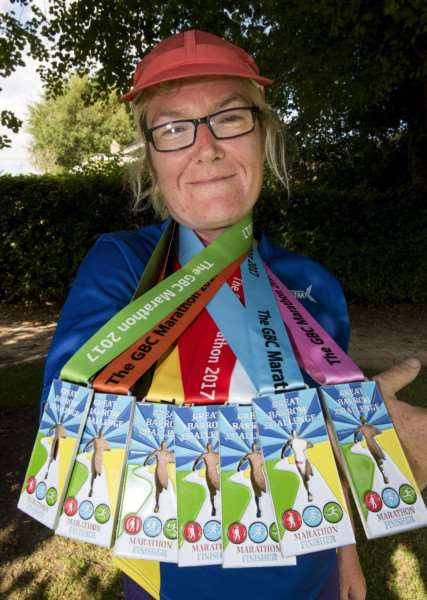 Melanie Sturman shows off her most recent medals