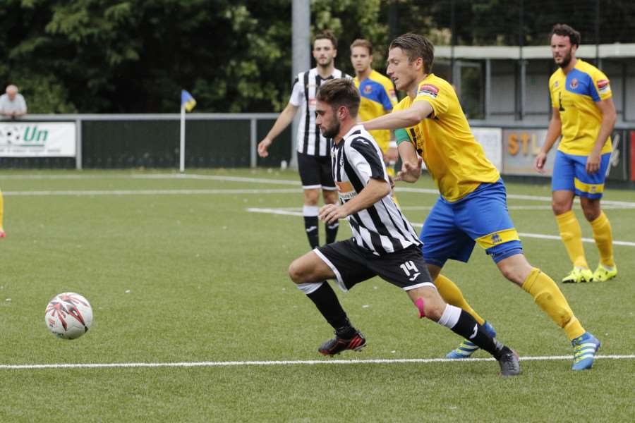 MIDFIELD BATTLE: Halstead's James Murray (black and white) tries to hold off Sudbury's Sam Clarke.