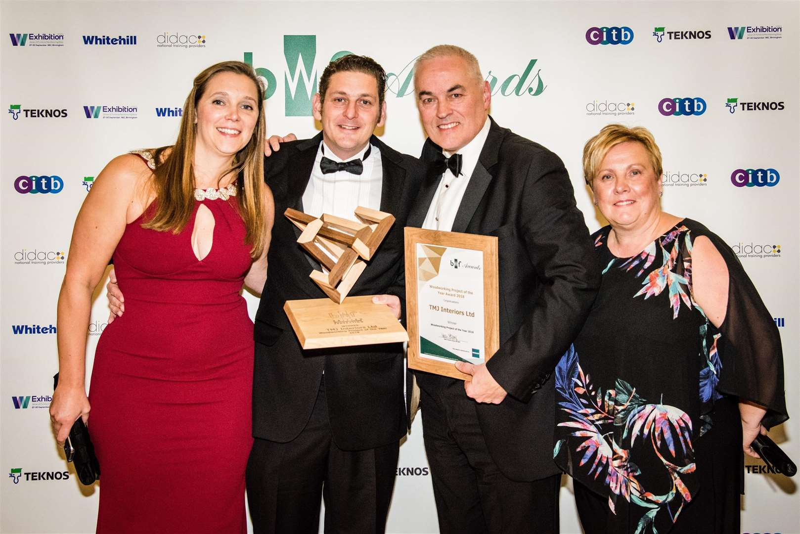 Laura Warren, Mark Hazell, Martin Holmes and Lorraine Holmes from TMJ Interiors collecting their award.