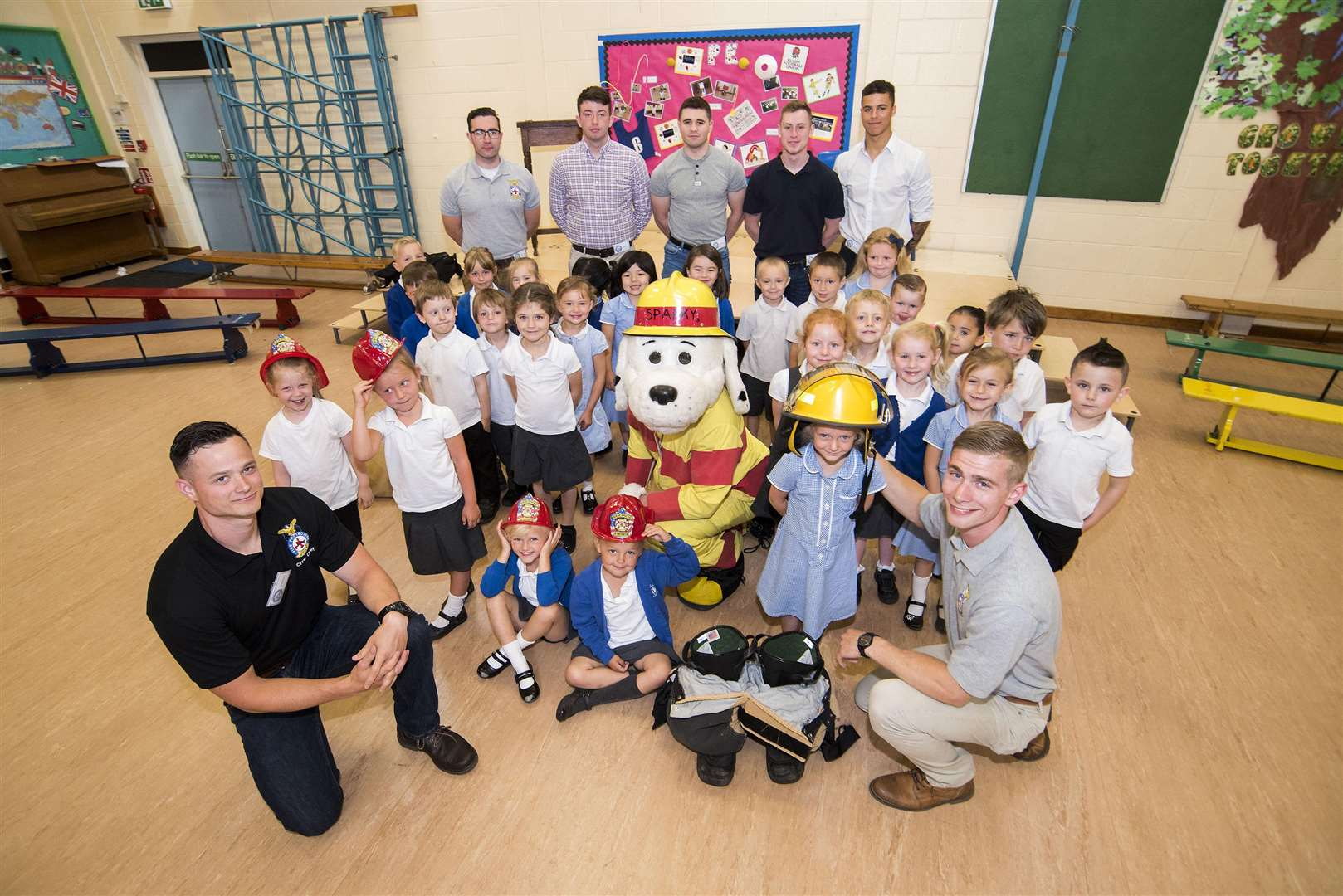 Sparky the Fire Dog and members of the USAF 100th Civil Engineer Squadron Fire Department and some of the children at Beck Row Primary Academy.