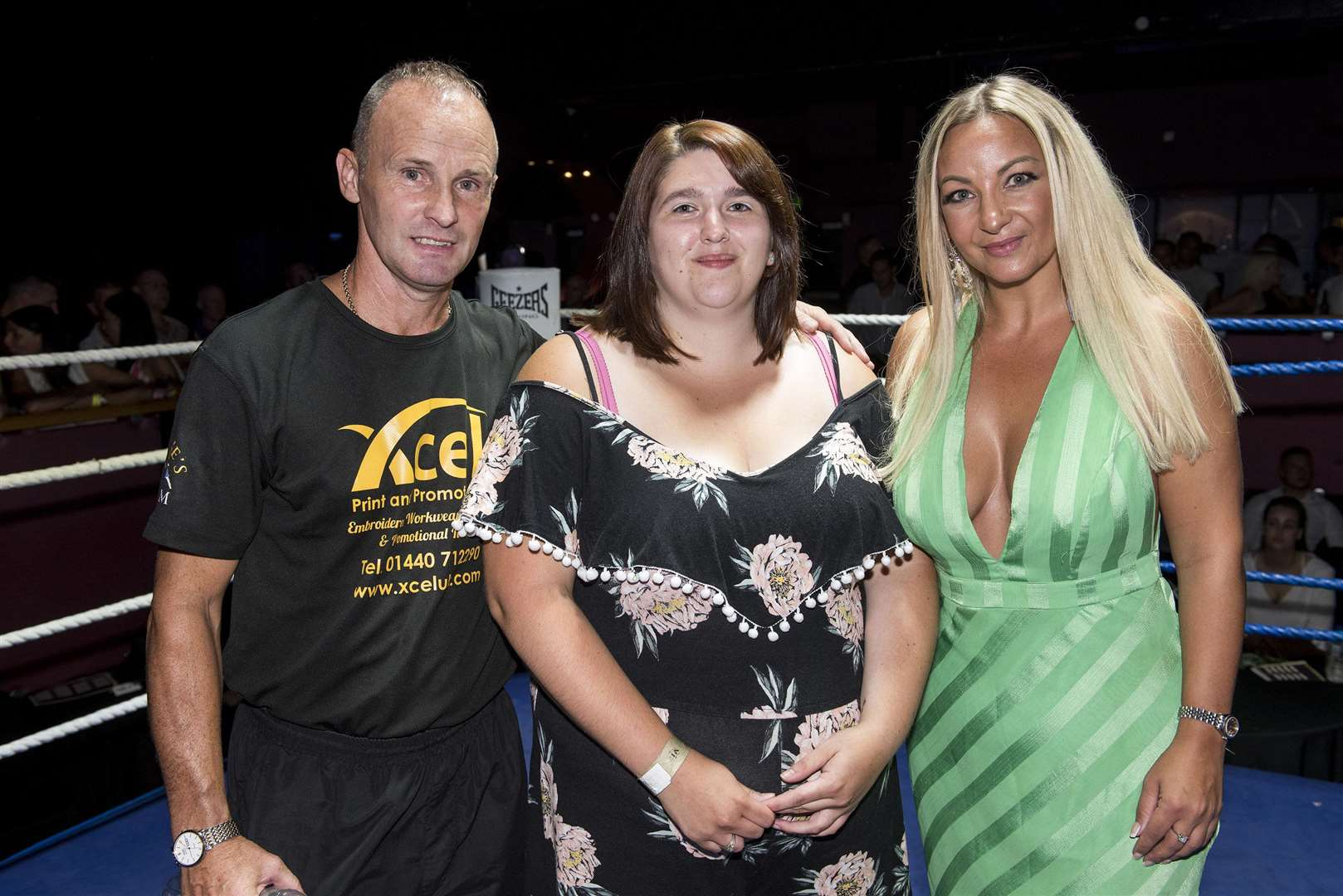 Rebecca McGrath, centre, is pictured at the fight night with Eddie Guest and co-promoter Becky Ross