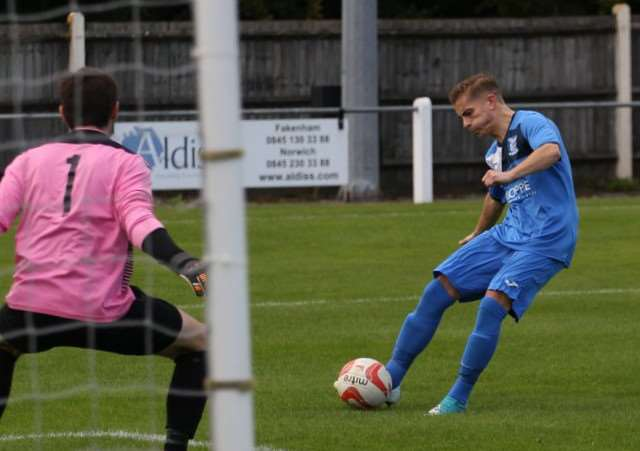 GOAL OPPORTUNITY: Craig Pruden scoring Haverhill Borough's opening goal in their victory over Fakenham Town, the team's first win in six fixtures