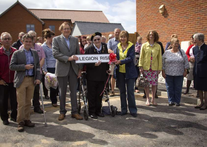 Villagers gather round after Sheila Ashford cut the ribbon at Legion Rise. Picture by Tony Stokes ANL-150515-172714001
