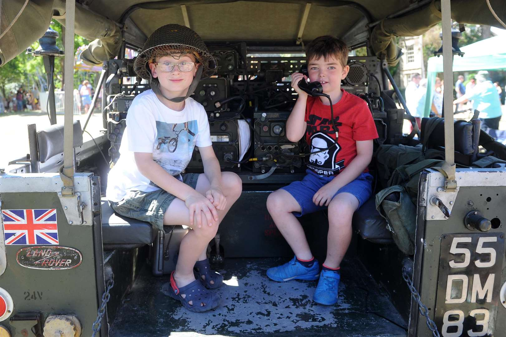 Oliver Davey, eight, and Harrison Shaw, six, on a 1961 Radio Communication Land Rover. Picture: Mecha Morton.