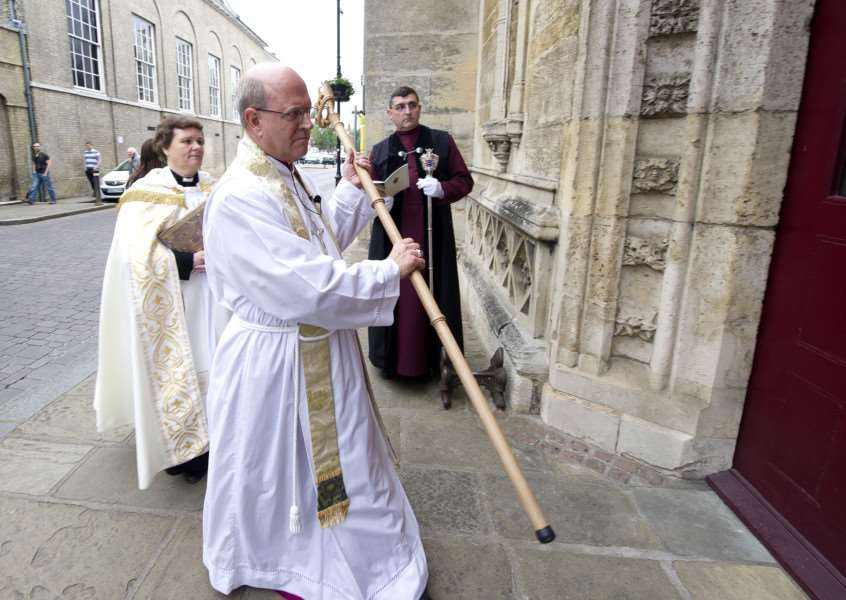 Enthronement of the Bishop os St Edmundsbury and Ipswich (Right Reverend Martin Seeley)''Pictured: Bishop Martin Seeley knocks on the door of the Cathedral