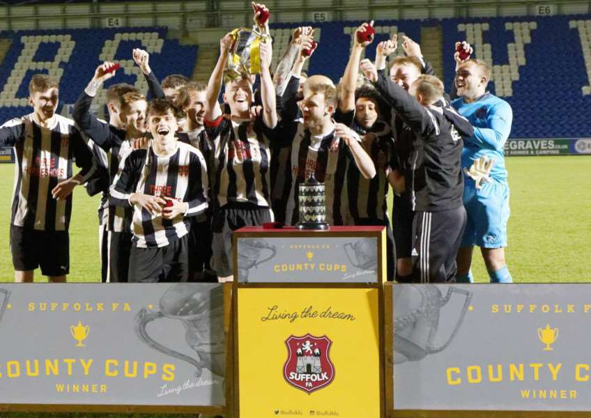 CUP WINNERS: Bures United players celebrate at Colchester United FC