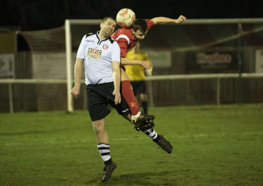 HEADS UP: Haverhill centre-back Marcus Hunt (left) is challenged by Ely striker Alex Theobald