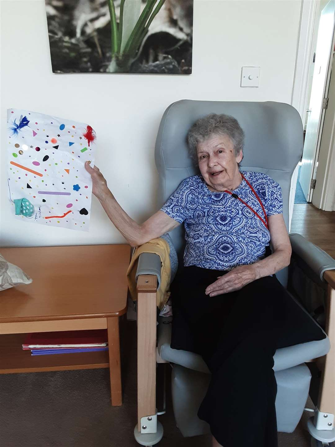 Resident Janet Lock with a picture sent from a child
