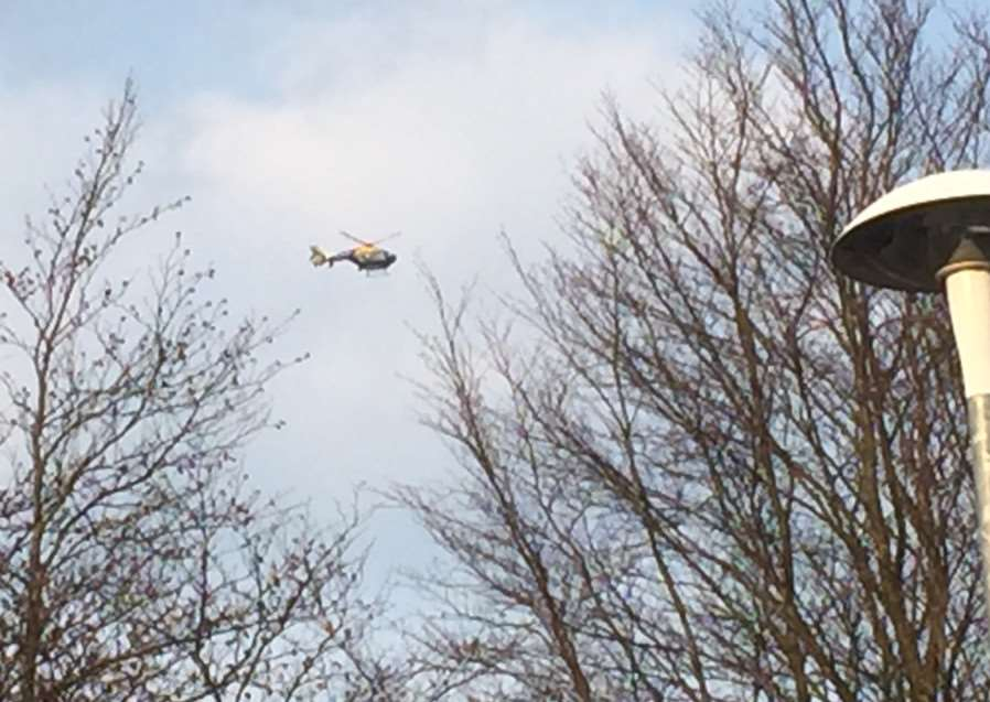 Police helicopter hovers over Haverhill housing estate near Tesco. ANL-150804-092118001