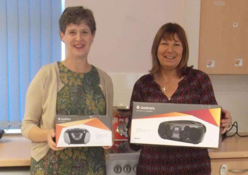 Granta School head teacher Lucie Calow, left, and Head of Sixth Form, Julie Lloyd with the new cooker and CD players.