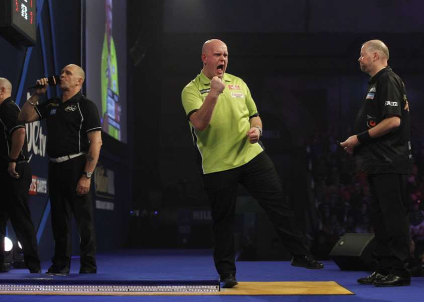 GREAT VIEWING: Russ Bray (left) calls another leg for Michael van Gerwen at Alexandra Palace. Picture: Lawrence Lustig/PDC
