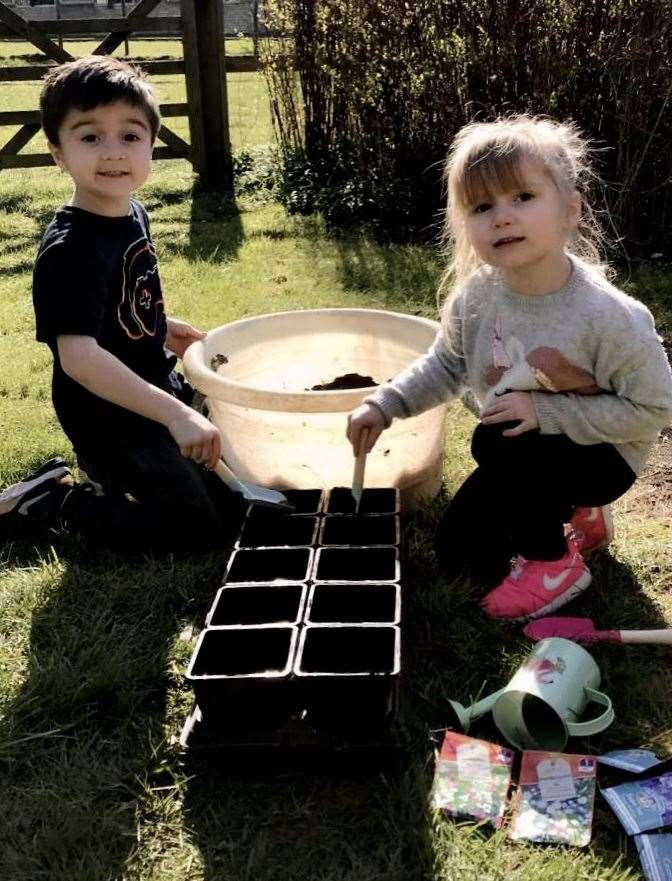 Ethan Rothwell and his sister Chloe, busy seed planting.
