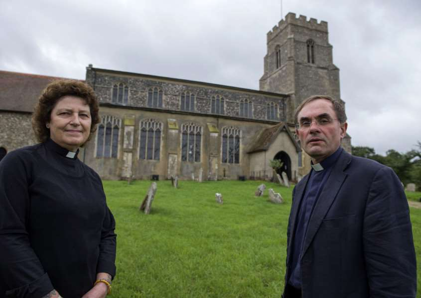 St Marys Church Combs, targeted by lead thieves, Parish Priest Chris Childs with Curate Rachel Cornish,'Picture Mark Westley ANL-150826-115113009