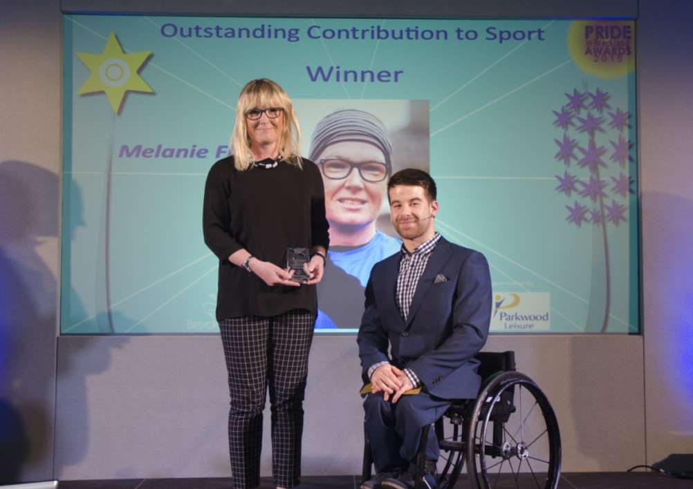 The Pride in Breckland Awards, Watton. Melanie Floyd from Thetford, winner of the Outstanding Contribution to Sport category, with Commonwealth athlete Will Smith, who presented the award. ANL-150323-170000001