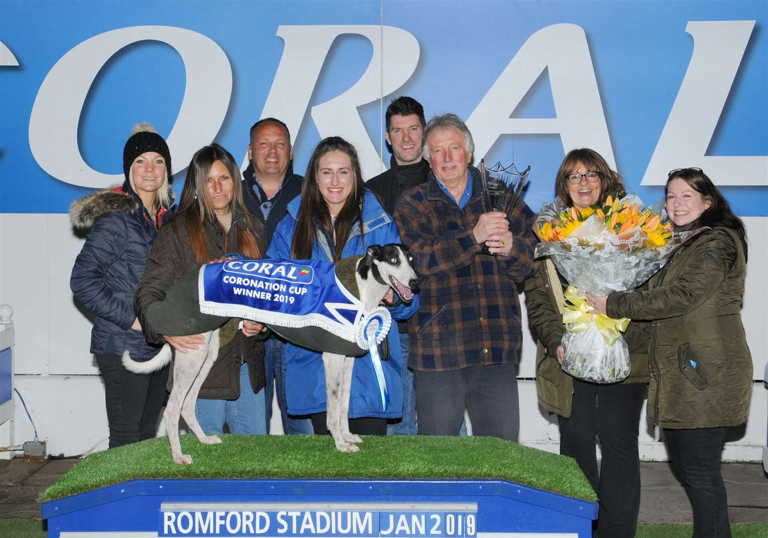 ALL SMILES: Owner Evan Herbert (with trophy), trainer Patrick Janssens (third from left) celebrate their success