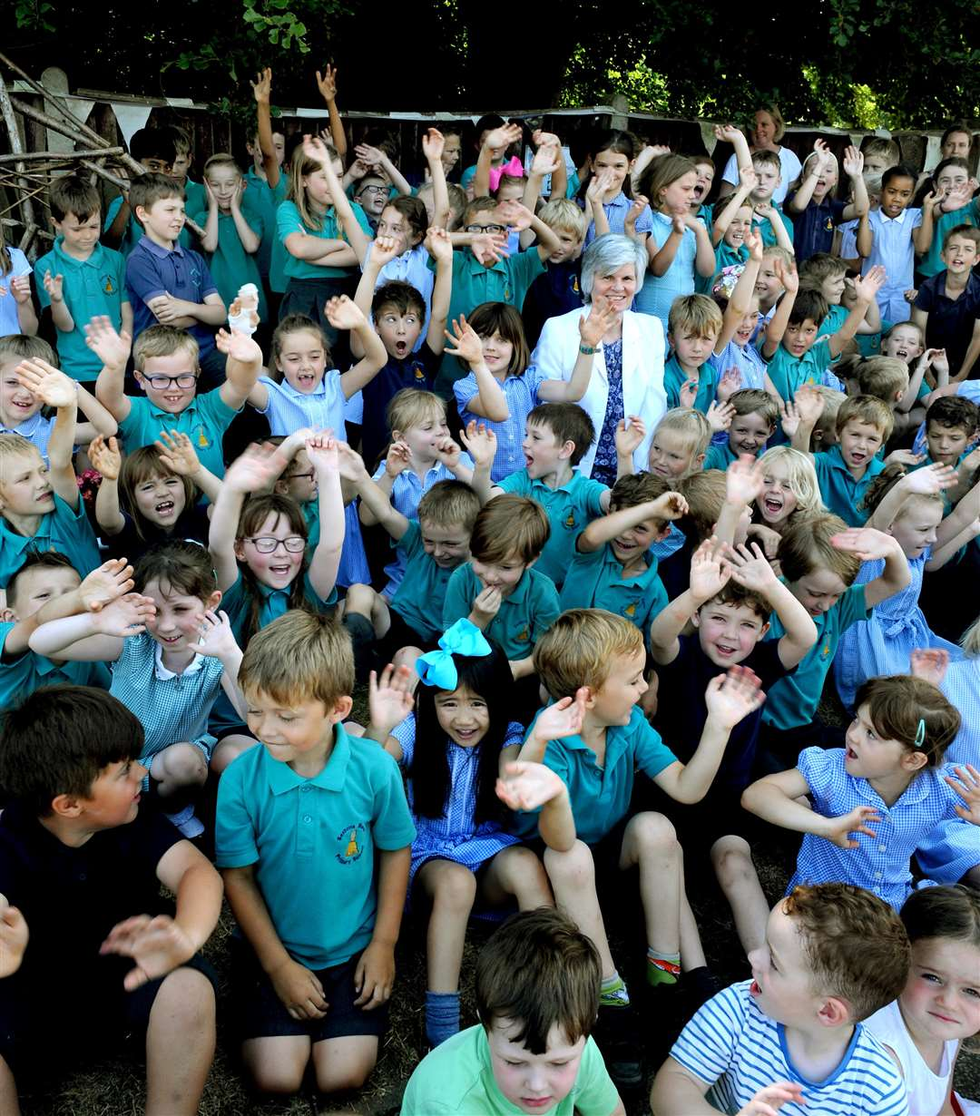 Headteacher Debbie Knight with staff and pupils at Sexton's Manor Primary School in Bury St Edmunds celebrating their good Ofsted rating following their recent inspection. Picture: Andy Abbott
